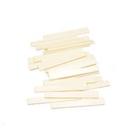 Free Shipping 100pcs Ivory Plastic 80x3x11.3-9.3MM Classical Guitar Saddle Guitar Parts Wholesale
