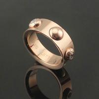 Titanium steel Yuanzhu nailing inlaid artificial diamond ring couple 18K rose gold ring