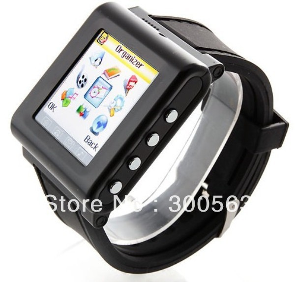 "Free shipping watch mobile phone with FM Camera,1.3"" touch screen,Triband Watch Phone,support B"
