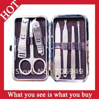 Free Shipping! 10pcs Mini 7 IN 1 Manicure Set Nail File Clipper Scissors Pedicure Tweezer Tool -- MSP30 Wholesale(China (Mainland))