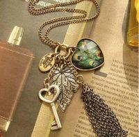 Ladies Retro Peacock Heart Leaf Key Tassel Necklace Fashion costume jewelry
