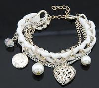 Free shipping 2014 new jewelry punk cutout heart corn beads bracelet chain ribbon love knitted multi-layer crystal pearl women