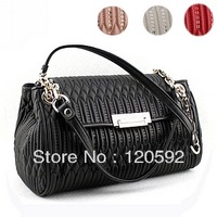 Free shipping! 2013 New Europe and the United States of metal chain goatskin ladies fashion handbag gules paillette package