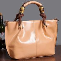 guaranteed 100%   Brand genuine leather handbag bright color cowhide totes SA00013