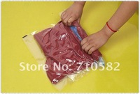 Free shipping 20pcs/lot 35*48cm Hand roll travel Vacuum storage bag for clothes