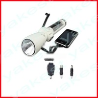 Crank dynamo solar powered torch with radio and charger
