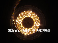 Free shipping  Warm white color LED flexible strip light 5MM 335SMD  emitting waterproof IP65 300leds/Reel
