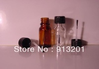 Amber essential oil bottle with cap and brush