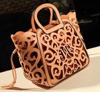 Retro carved hollow fringed bag laptop bag new female bag cutout big bag shoulderbag diagonal