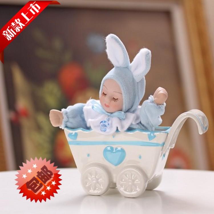 frete grátis/cerâmica manivela caixa de música/bonito bebê dormindo/tremendo boneca cabeça/coelho orelhas grandes/aniversário presente de natal(China (Mainland))