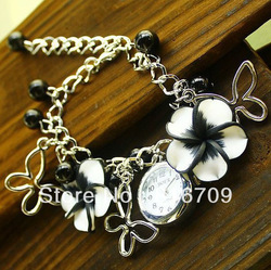 Hot 8 Colors Women Fashion Flower Quartz Watch Beautiful Stainless Blacelet Wristwatches for Ladies Airmail Free Shipping(China (Mainland))